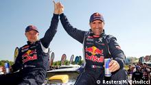Peugeot driver Stephane Peterhansel (R) and co-pilot Jean Paul Cottret of France react at the end of the 13th and final stage of the Dakar Rally 2016 in Cordoba province, Argentina, January 16, 2016. REUTERS/Marcos Brindicci TPX IMAGES OF THE DAY Reuters/M. Brindicci
