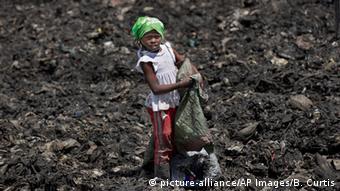 Kenyan child collects rubbish in a Nairobi slum