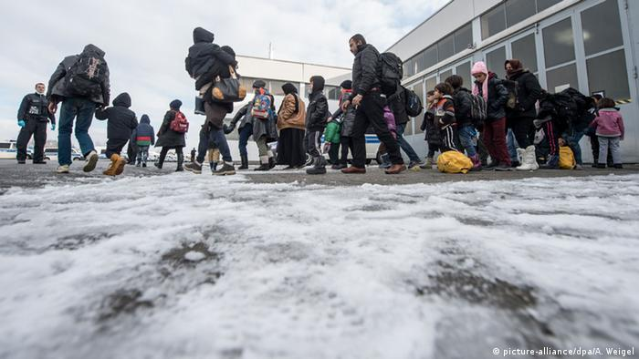 refugees in snow in Germany