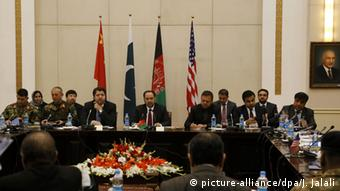 Afghan Foreign Minister, Salahuddin Rabbanion (C) chairs the second round of four-way peace talks meeting with Afghanistan, US and Chinese delegates at the Presidential palace in Kabul, Afghanistan, 18 January 2016 (Photo: picture-alliance/dpa/J. Jalali)