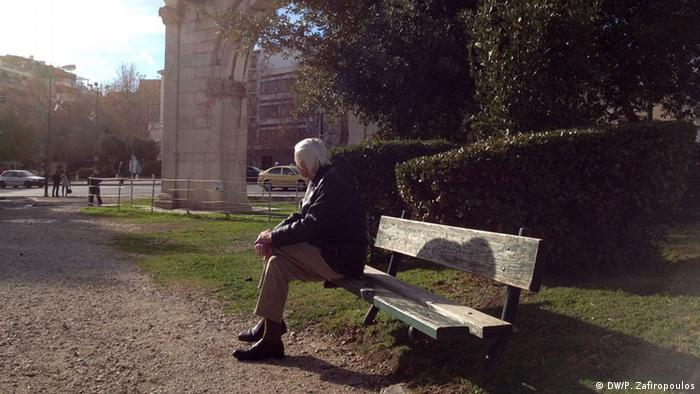 man sitting on park bench copyright: Pavlos Zafiropoulos