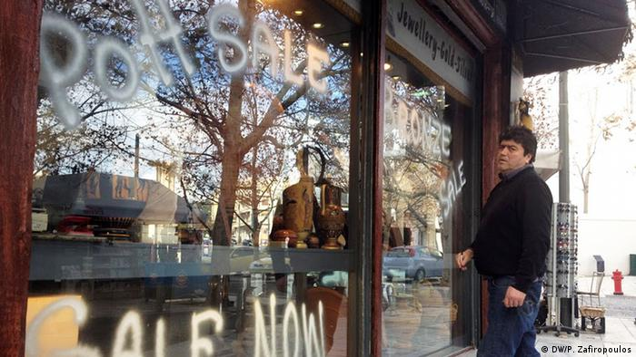man standing outside shop window copyright: Pavlos Zafiropoulos