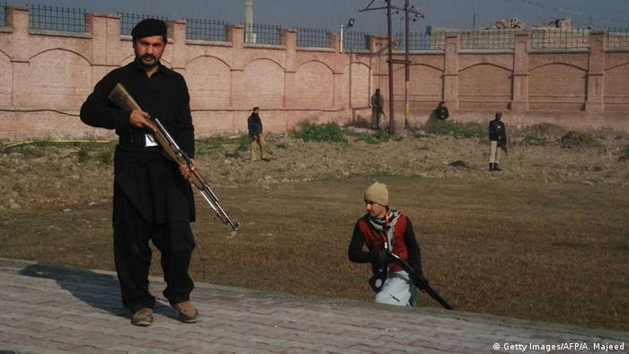 Pakistani security personnel taking position outside the Bacha Khan university following an attack by gunmen in Charsadda, about 50 kilometres from Peshawar, on January 20, 2016 (Photo: A MAJEED/AFP/Getty Images)