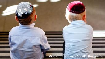 Two boys wearing yarmulkes