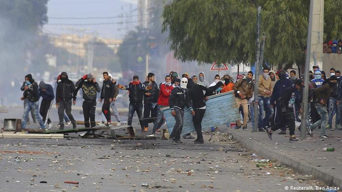 Protesters blocked a road in Kasserine as police fired tear gas