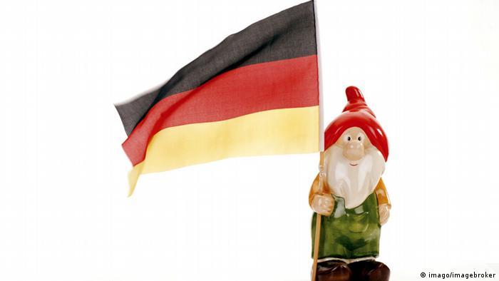 German flag held by plastic gnome Copyright:imago/imagebroker