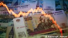 File photo illustration shows a reflection of a yearly chart of U.S. dollars and Russian roubles on rouble notes in Warsaw, Poland, November 7, 2014. The Russian rouble weakened to a new record low against the dollar on January 20, 2016, as the mood on global markets was torrid and oil prices slumped. REUTERS/Kacper Pempel/Files Reuters/K. Pempel