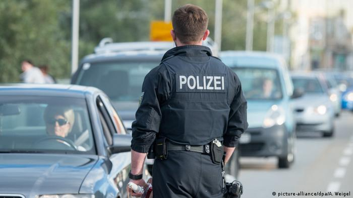Police officer and cars