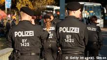PASSAU, GERMANY - OCTOBER 28: German police watch migrants arriving at the border to Austria on October 28, 2015 near Wegscheid, Germany. Bavarian Governor Horst Seehofer has accused the Austrian government of wantonly shuttling migrants in buses from the Slovenian border across Austria and dumping them at all hours of day and night at the border to Germany. German authorities have recorded over 7,000 migrants arriving daily since the weekend as a bottleneck of migrants in Slovenia and Croatia finally arrived in Austria. Germany has registered over 800,000 migrants this year and Chancellor Angela Merkel is mounting pressure on European Union member states that so far have shown great reluctance to accept any migrants at all to finally share the burden of accommodating the newcomers, many of whom are refugees fleeing war-torn Syria. (Photo by Johannes Simon/Getty Images) +++ (C) Getty Images/J. Simon