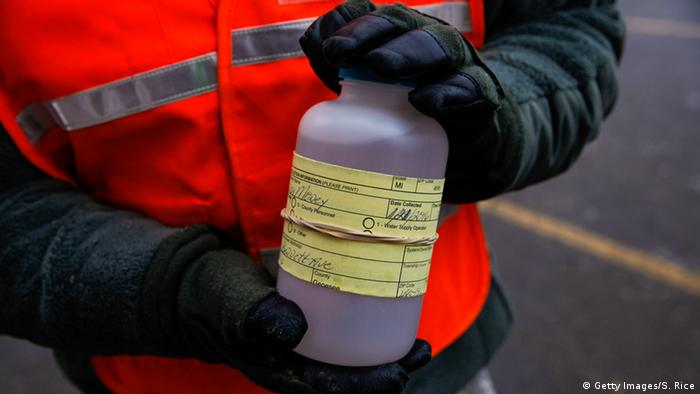 National Guard showing water samples from Flint, Michigan