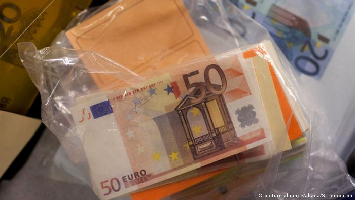 899,000 counterfeit notes were taken out of circulation across the globe