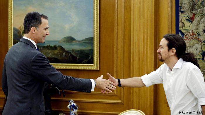 Podemos (We Can) party leader Pablo Iglesias (R) shakes hands with Spain's King Felipe during their meeting at the Zarzuela Palace in Madrid, Spain