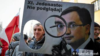 People demonstrate during an anti-government rally in Gdansk, Poland January 23, 2016. The poster shows Justice Minister Zbigniew Ziobro and reads XI Eleventh: Don't watch!