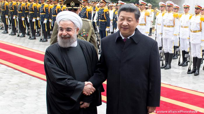 Iranian President Hassan Rouhani meets with Chinese President Xi Jinping in Iran