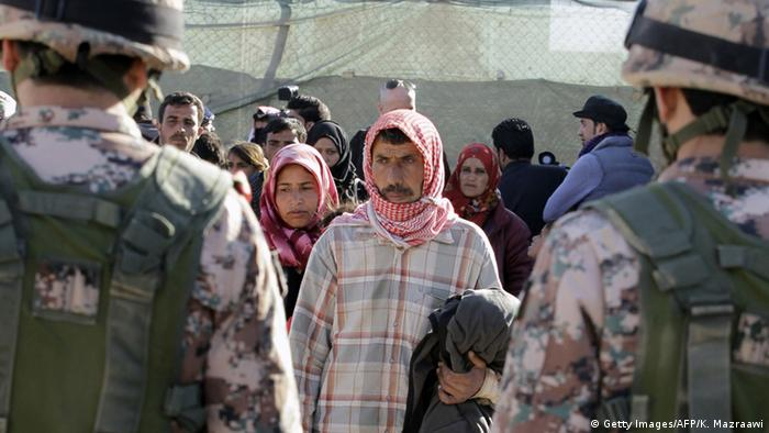 Syrian refugees at the Jordanian border (photo: KHALIL MAZRAAWI/AFP/Getty Images)