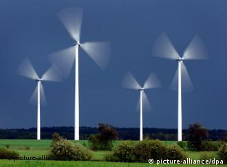Image of four windmills at work in the landscape