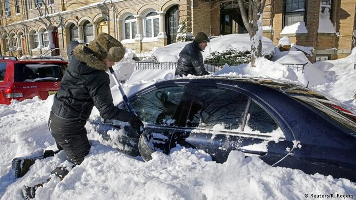 Residents dig their car out of the snow in Union City, New Jersey