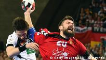 24.01.2016 Germany's Fabian Wiede (L) challenge Russia's Mikhail Chipurin during the Men's 2016 EHF European Handball Championships between Germany and Russia in Centennial Hall in Wroclaw on January 24, 2016. / AFP / JANEK SKARZYNSKI (Photo credit should read JANEK SKARZYNSKI/AFP/Getty Images) Copyright: Getty Images/AFP/J. Skarzynski