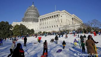 People sled and play in the snow on the hill below the U.S. Capitol in Washington