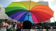 17.05.2015 **** JAKARTA, INDONESIA - May 17: A supporter of lesbian, gay, bisexual, and transgender (LGBT) join a march to mark the International Day Against Homophobia, Biphobia and Transphobia (IDAHOT) in Jakarta, Indonesia, on May 17. The Day once more provides an important space for the LGBTI community to be visible. And to provide evidence of the effects of homophobia, transphobia and biphobia on the day-to-day lives of LGBTI youth. In many countries around the world, IDAHOT has now evolved into a full week of action, often interweaving festive, cultural and political actions. (Solo Imaji). (Photo by Agoes Rudianto/NurPhoto) C: picture-alliance/NurPhoto/A. Rudianto
