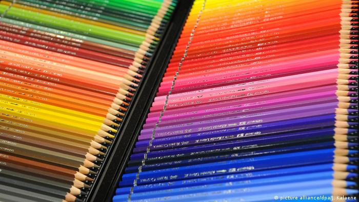 Colored pencils sit in a row