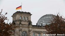 German flag at half mast on the Bundestag building in Berlin