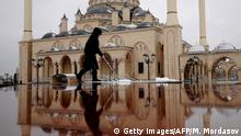 A female municipal worker cleans the square in front of Akhmad Kadyrov Central Dome Mosque, known as 'Heart of Chechnya', in the Chechnya's provincial capital Grozny, on March 9, 2011. The mosque design is based on the Blue Mosque in Istanbul. AFP PHOTO/ MIKHAIL MORDASOV (Photo credit should read MIKHAIL MORDASOV/AFP/Getty Images) +++ (C) Getty Images/AFP/M. Mordasov