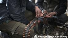 Fighters from rebel factions and Jaish al-Islam (Islam Army), the foremost rebel group in Damascus province who fiercely oppose to both the regime and the Islamic State group, prepare their ammunition in Harasta Qantara, near Marj al-Sultan on the eastern outskirts of Damascus, on January 23, 2016, during clashes with government forces after they infiltrated into the government-held area. / AFP / AMER ALMOHIBANY (Photo credit should read AMER ALMOHIBANY/AFP/Getty Images) Getty Images/A.Almohibany