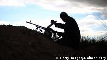A fighter from Jaish al-Islam (Islam Army), the foremost rebel group in Damascus province who fiercely oppose to both the regime and the Islamic State group, loads his weapon in Harasta Qantara, near Marj al-Sultan on the eastern outskirts of Damascus, on January 23, 2016, during clashes with government forces after they infiltrated into the government-held area. / AFP / AMER ALMOHIBANY (Photo credit should read AMER ALMOHIBANY/AFP/Getty Images) Getty Images/A.Almohibany