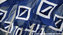 Deutsche Bank flags (picture-alliance/dpa/A.Dedert)