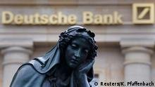 28.01.2016 **** A statue is seen next to the logo of Germany's Deutsche Bank in Frankfurt, Germany, January 26, 2016. Germany's largest business bank will present its annual figures during a news conference on Thursday, January 28. REUTERS/Kai Pfaffenbach TPX IMAGES OF THE DAY © Reuters/K. Pfaffenbach