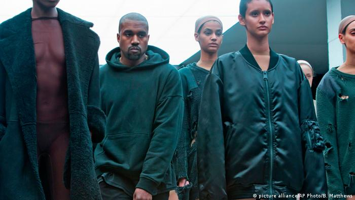 Kanye West Mode standing with models at the 2015 presentation Yeezy