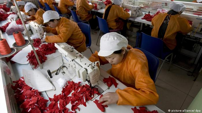 Chinese workers (picture-alliance/ dpa)