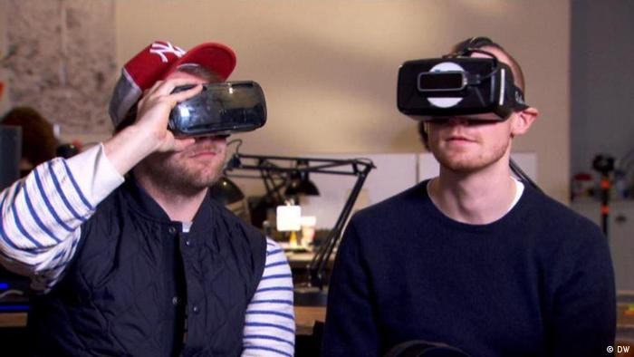 Two men wearing Virtual Reality glasses (Photo: DW)