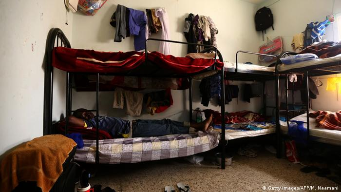 A Ghanaian laborer sits in his room at a private camp housing foreign workers in Doha