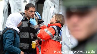 Medical staff check a refugee upon arrival at Munich's main train station in September 2015