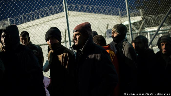 Refugees wait to be registered on Lesbos