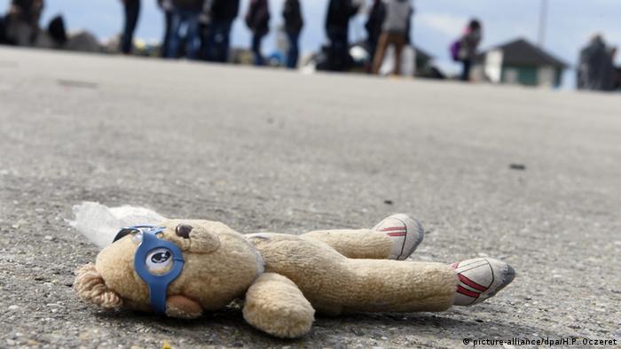 Teddy bear lying on ground
