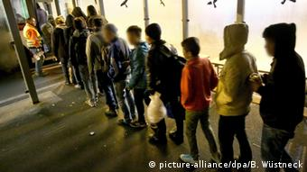 refugees standing in line