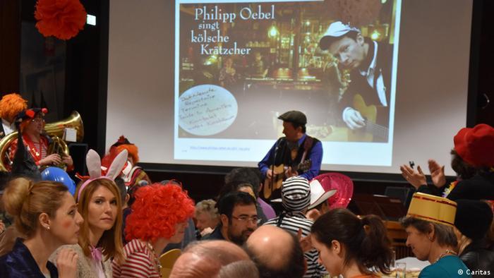 Deutschland Karneval Köln Aufklärung für Flüchtlinge
