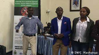 Three young Zimbabweans singing in opposition to underage smoking (Photo: DW / Columbus Mavhunga)