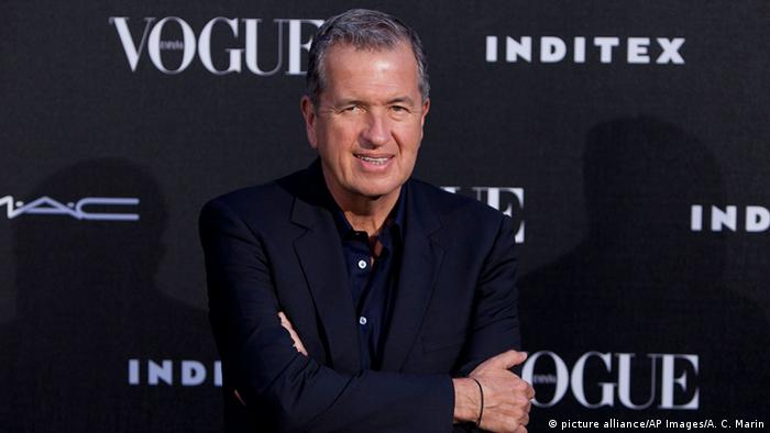 Photographer Mario Testino poses for photographers during the photocall