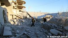 Residents inspect damage after airstrikes by pro-Syrian government forces in Anadan city, about 10 kilometers away from the towns of Nubul and Zahraa, Northern Aleppo countryside, Syria February 3, 2016. REUTERS/Abdalrhman Ismail Reuters/A.Ismail