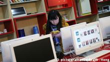 epa05020466 A consumer views online shopping websites at a store of JD.com online shopping website in an university in Beijing city, China, 11 November 2015. Chinese internet giant Alibaba made 5 billion dollars in the first 90 minutes of the country's 'Singles Day' online shopping binge on 11 November, defying fears of an economic slowdown in the world's second-largest economy. Alibaba rival and China's largest online direct sales company, JD.com, said on 11 November that its website had clocked up 10 million orders by 10 am (0200 GMT), which is up 180 per cent from the site's total number of orders on Singles Day last year. EPA/WU HONG Copyright: picture-alliance/dpa/W. Hong