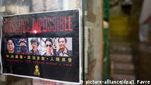 5.2.2016 *** epa05144039 A flyer that reads 'Missing: Impossible' with the photos of 5 missing booksellers hangs on the entrance to Causeway Bay Books store in Hong Kong, China, 05 February 2016. Guangdong police have finally confirmed that booksellers Lam Wing-kee, Cheung Chi-ping and Lui Por, are being investigated in mainland China. The three plus Gui Minhai and Lee Po, also held by Chinese police, are associated with the publishing house 'Mighty Current' and Causeway Bay Books that publish and sell books critical of mainland China leaders and the Chinese Communist Party. EPA/JEROME FAVRE +++(c) dpa - Bildfunk+++ Copyright: picture-alliance/dpa/J. Favre