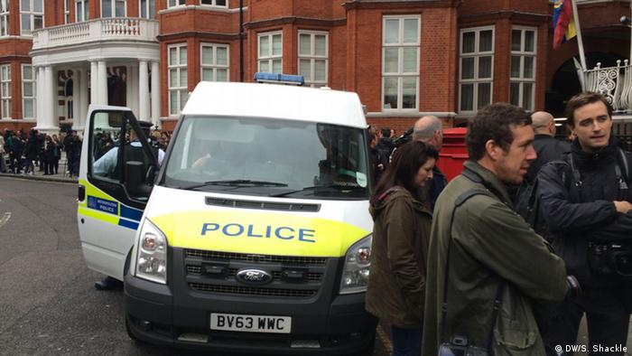 Press and polcie outside the Ecuadorian embassy in London