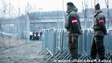 epaselect epa05133174 Two Austrian soldiers patrol along the Slovenian-Austrian border during a visit of Austrian Minister of Defense Hans Peter Doskozil at a temporary camp at the Slovenian-Austrian border, near the village of Spielfeld, Austria, 29 January 2016. Austria unveiled a plan on 20 January to cap the number of new asylum seekers it will take in the coming years, prompting reactions by politicians across Europe and highlighting a divide in how governments plan to handle a record influx of refugees. Austria decided to limit refugee numbers to 37,500 this year - a sharp drop from the 120,000 asylum claims the Alpine country was expecting. EPA/MARIJA KANIZAJ +++(c) dpa - Bildfunk+++ Copyright: picture-alliance/dpa/M. Kanizaj