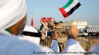 citizens greeting a convoy of UAE military vehicles and personnel as it travels from Al Hamra Military Base to Zayed Military City, marking the return of the first batch of UAE Armed Forces military personnel from Yemen, at Marfa, western region of Abu Dhabi,
