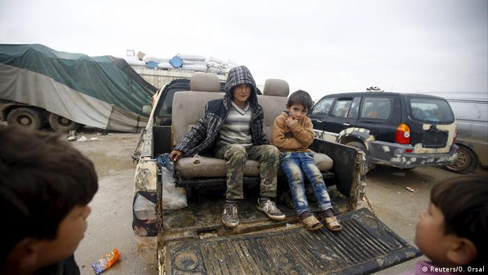 two children sitting on back of truck Copyright: Reuters/O. Orsal