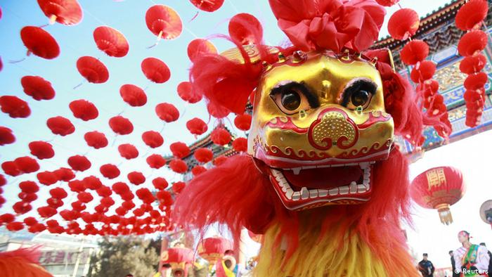 Dancers perform the lion dance at the beginning of Chinese Lunar New Year in Beijing (Reuters)